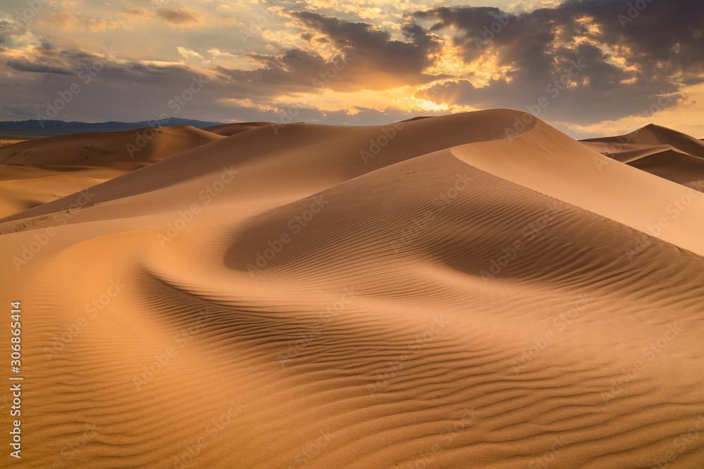 Fototapeta Sunset over the sand dunes in the desert
