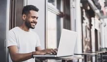 Smiling Man Using Laptop Compu...