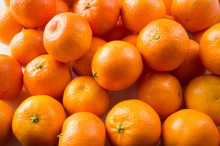 Top View. Fresh Tangerines. Ripe And Tasty Mandarins. Clementines. Background Tangerines.