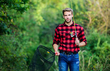 Fishing Day. Handsome Guy In Checkered Shirt With Fishing Equipment Nature Background. Fishing In My Hobby. Hipster Fisherman With Rod Spinning Net. Hope For Nice Fishing. Summer Weekend Concept