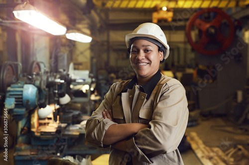 Leinwand Poster Waist up portrait of mixed-race female worker posing confidently while standing