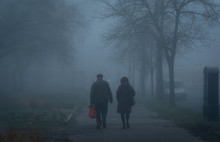 Old Couple Walking On Street A...