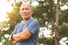 Asian Senior Man In Blue Shirt...