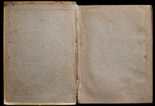 Antique Book Unfolded On The Endpaper, Showing Aged Textured Paper Inside, Isolated On Black Background.