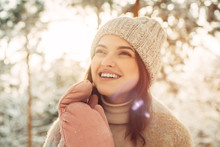 Happy Young Woman In A Knitted...