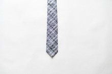 Overhead Shot Of A Gray Tie On A White Surface