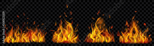 Fototapeta Set of translucent burning campfires of flames and sparks on transparent background