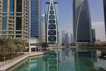 Jumeirah Lake Towers Area Overview With Building Reflection On The Water