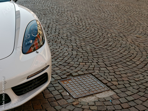Fotografie, Obraz  MONTANYANA, ITALY - AUGUST 26, 2019: White car on the city pavement