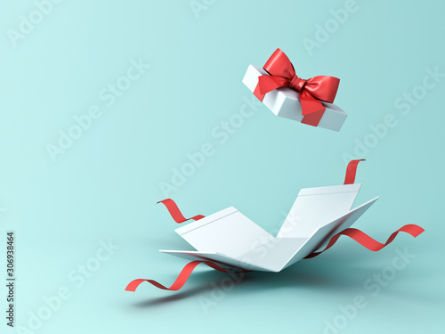 Open present box or gift box with red ribbons and bow isolated on green blue pas Tablou Canvas
