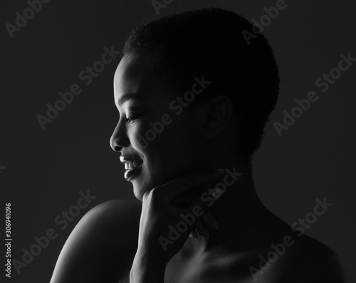 Black and white profile portrait of beautiful afro woman
