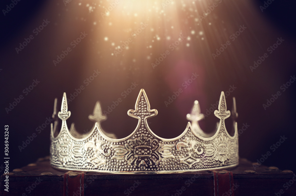 Fototapeta low key image of beautiful queen/king crown over wooden table. vintage filtered. fantasy medieval period