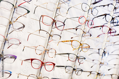 Fotografía Glasses showcase in modern optic shop