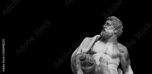 Ancient statuue of Hercules on black background Fototapet