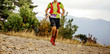 canvas print picture - young male runner with camelbak run mountain ultra marathon