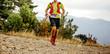 Leinwanddruck Bild - young male runner with camelbak run mountain ultra marathon