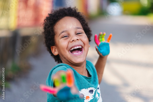Fototapeta beautiful happy boy with painted hands obraz