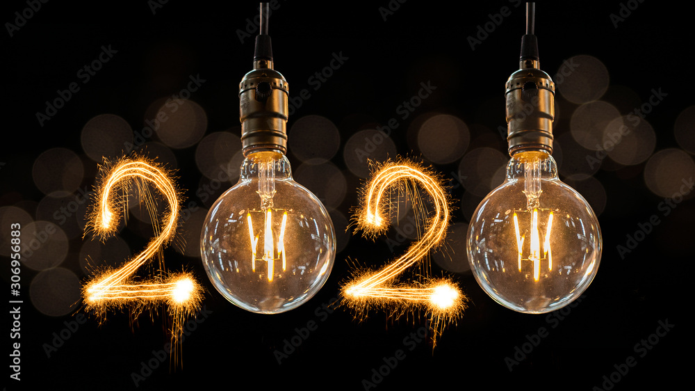 Fototapeta Luxury beautiful retro or vintage dirty light bulb decor hanging with 2020 Happy new year concept written number by sparkle firework