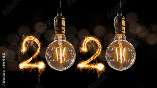 Obraz Luxury beautiful retro or vintage dirty light bulb decor hanging with 2020 Happy new year concept written number by sparkle firework - fototapety do salonu