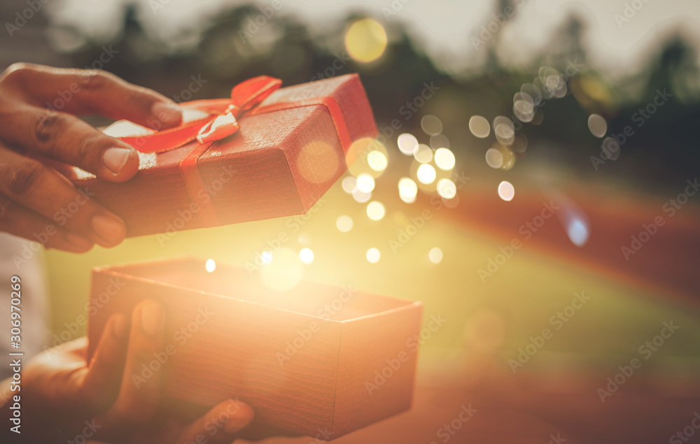 Fototapeta He opened a wonderful gift box for his lover.Concept merry christmas and happy new year 2020