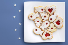 Romantic Concept With Linzer Cookies And Small Sugar Snowflakes