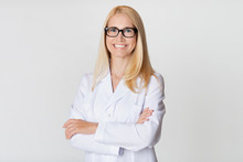 Friendly Woman Doctor In White Uniform, Smiling To Camera