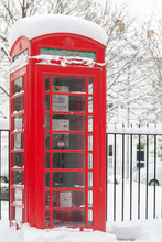 Retro Phone Booth In The Snow