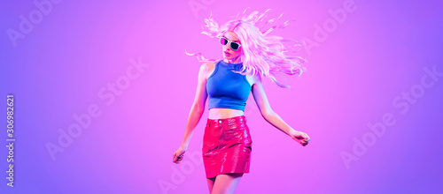 Adorable Fashion woman in party outfit dance, Trendy neon light hairstyle. Ni...