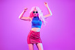 canvas print picture - Adorable Fashion woman in party outfit dance, Trendy neon light hairstyle. Night club music vibes, gel filter. Excited shapely beautiful sexy girl dancing. Pop Art fashionable creative neon color.