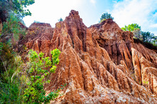 High Red Clay Rocks And Cliffs Washed By Winter Rains And Surface Water Flows. Clay Quarry, Mines Landscape Scene In Cilento And Vallo Di Diano National Park In Campania, Italy