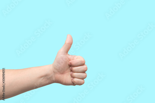Closeup of male hand showing thumbs up sign Wallpaper Mural