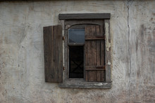 Old Wooden Window On The Wall Of Village House
