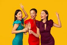 Three Women In Dresses Clinkin...