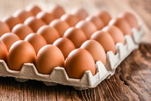 Brown Egg, Chicken Eggs In Caton On Wooden Table.