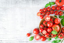 Fresh Tomatoes And Basil On Wh...