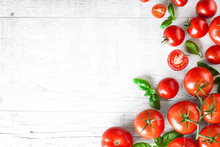 Fresh Ripe Tomatoes On White Background Top View. Tomato Red Vegetable Concept, Copy Space For Text With Basil Leaves.