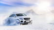 Car drifting on snow in winter mountains. Luxury cars race speed on snowy or ice road with back light.