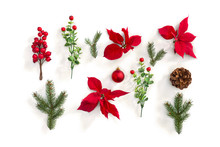Christmas Decoration. Flowers Of Red Poinsettia, Branch Christmas Tree, Ball, Cone Pine, Red Berry On A White Background. Top View, Flat Lay