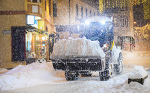 Highway Maintenance Heavy Truck Cleaning Road During Blizzard Or Snowstorm In Evening, Winter Transport Calamity Removing In Center Of City.