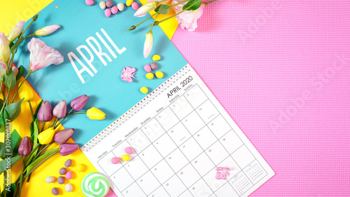 On-trend 2020 calendar page for the month of April modern flat lay with seasonal food, candy and colorful decorations in popular pastel colors Canvas Print