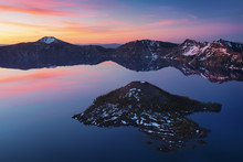 Volcanic Lake In Mountains At Sunrise With Colorful Reflection