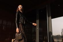 Street Fashion. Beautiful Young Woman In Sunglasses. Glamorous, Model Gait. Urban Fashion.