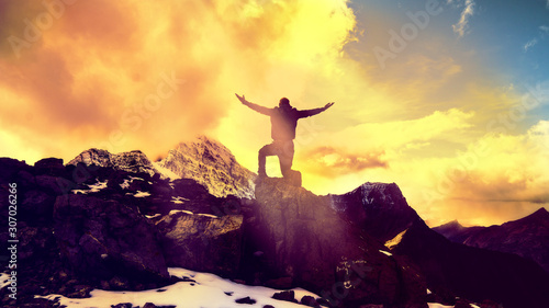 Man Praying Kneeling With Arms Open On Epic Mountain Top Summit With Light Shini Wallpaper Mural