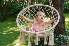 Little Girl On A Swinging Hamm...