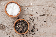Salt And Pepper On A Wooden Bakground