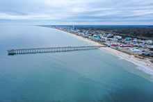 Aerial View Of Ocean Crest Fishing Pier At Oak Island NC. Looking At The Pier And Beach Front.