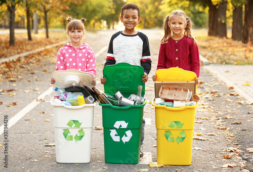 Little children collecting trash outdoors. Concept of recycling Canvas Print