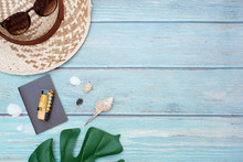 Flat Lay Vacation Planing And Travel In Summer Holiday Concept On Vintage Wooden Table Background With Passport And Train, Sunglasses And Straw Hat, Accessory, Top View With Copy Space