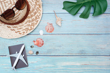 Flat Lay Vacation Planing And Travel In Summer Holiday Concept On Vintage Wooden Table Background With Passport And Plane, Sunglasses And Straw Hat, Accessory, Top View With Copy Space