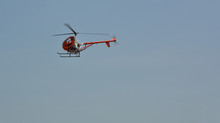 Small Helicopter Flying On A S...